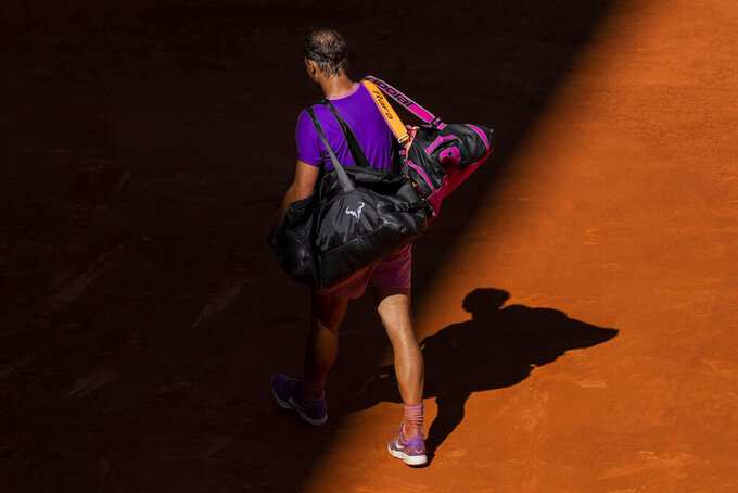 Spain's Rafael Nadal leaves the court after losing against Germany's Alexander Zverev at the Mutua Madrid Open tennis tournament in Madrid, Spain, Friday, May 7, 2021. (AP Photo/Bernat Armangue)
