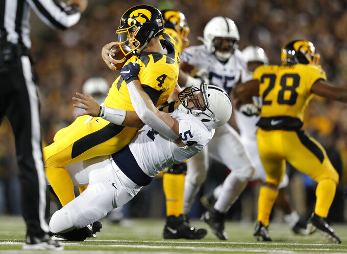 Penn State defensive tackle Robert Windsor, center, sacks Iowa quarterback Nate Stanley during the second half of an NCAA college football game Saturday, Oct. 12, 2019, in Iowa City, Iowa. (AP Photo/Matthew Putney)