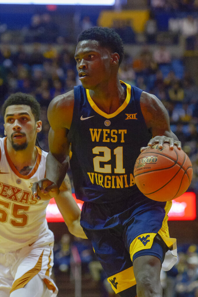 West Virginia forward Wesley Harris (21) drives downcourt during the second half of an NCAA college basketball game against Texas in Morgantown, W.Va., Saturday, Feb. 9, 2019. (AP Photo/Craig Hudson)