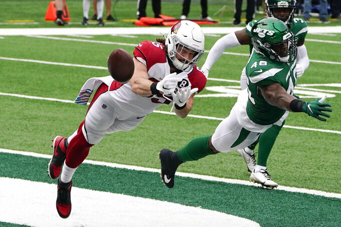 Arizona Cardinals tight end Dan Arnold (85) misses a touchdown pass against New York Jets linebacker Neville Hewitt (46) during the first half of an NFL football game, Sunday, Oct. 11, 2020, in East Rutherford. (AP Photo/Seth Wenig)