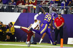 Minnesota Vikings cornerback Xavier Rhodes (29) breaks up a pass intended for Washington Redskins wide receiver Terry McLaurin (17) during the first half of an NFL football game, Thursday, Oct. 24, 2019, in Minneapolis. (AP Photo/Bruce Kluckhohn)