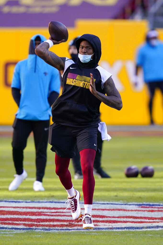 Washington Football Team quarterback Dwayne Haskins (7) throwing the ball before the start of an NFL football game against the Carolina Panthers, Sunday, Dec. 27, 2020, in Landover, Md. (AP Photo/Susan Walsh)