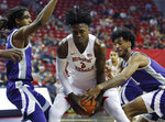 UNLV's Donnie Tillman, center, drives through Kansas State's Cartier Diarra, left, and Antonio Gordon during the first half of an NCAA college basketball game, Saturday, Nov. 9, 2019, in Las Vegas. (AP Photo/John Locher)