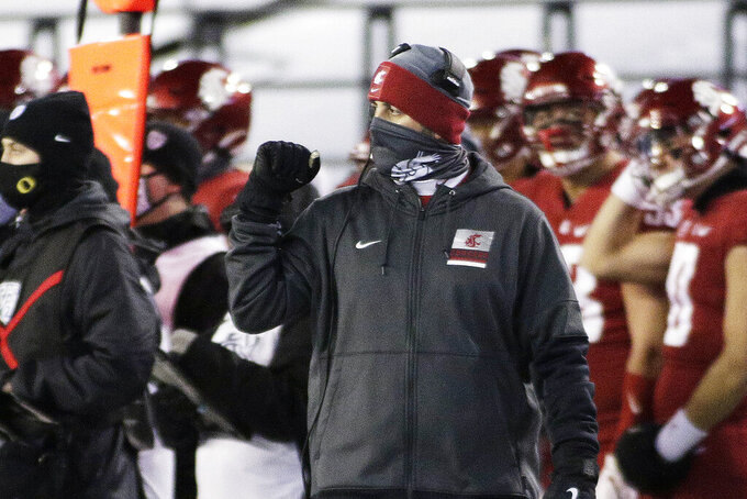 Washington State coach Nick Rolovich walks along the sideline during the first half of the team's NCAA college football game against Oregon in Pullman, Wash., Saturday, Nov. 14, 2020. (AP Photo/Young Kwak)