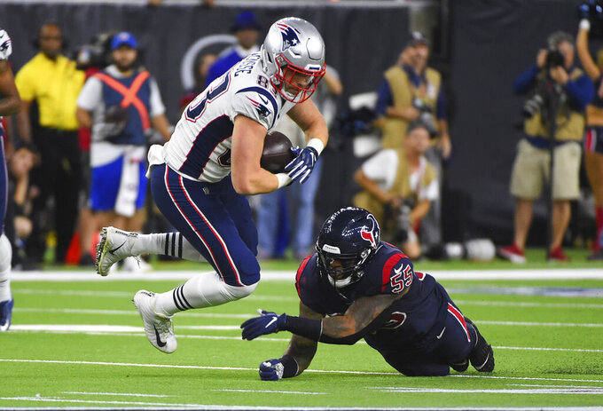New England Patriots tight end Matt LaCosse (83) is upended by Houston Texans inside linebacker Benardrick McKinney (55) during the first half of an NFL football game Sunday, Dec. 1, 2019, in Houston. (AP Photo/Eric Christian Smith)