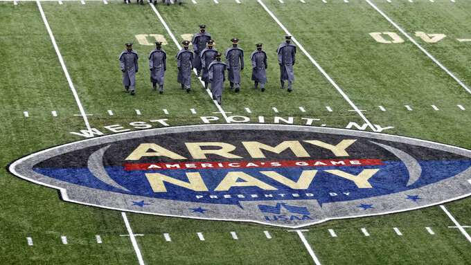 Army cadets march on the field before an NCAA college football game against Navy on Saturday, Dec. 12, 2020, in West Point, N.Y. (AP Photo/Adam Hunger)