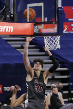 Santa Clara forward Guglielmo Caruso shoots during the first half of an NCAA college basketball game against Gonzaga in Spokane, Wash., Thursday, Feb. 25, 2021. (AP Photo/Young Kwak)