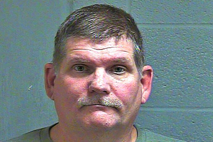 This undated photo provided by the Oklahoma County Sheriff's Office shows Timothy Harper. Harper, a self-described Second Amendment