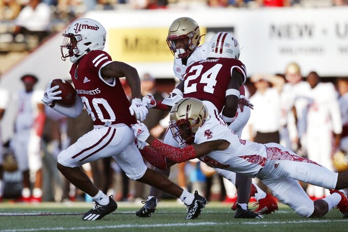 Massachusetts wide receiver Eric Collins (80) breaks away from Boston College defensive back Elijah Jones during the second half of an NCAA college football game, Saturday, Sept. 11, 2021, in Amherst, Mass. (AP Photo/Michael Dwyer)