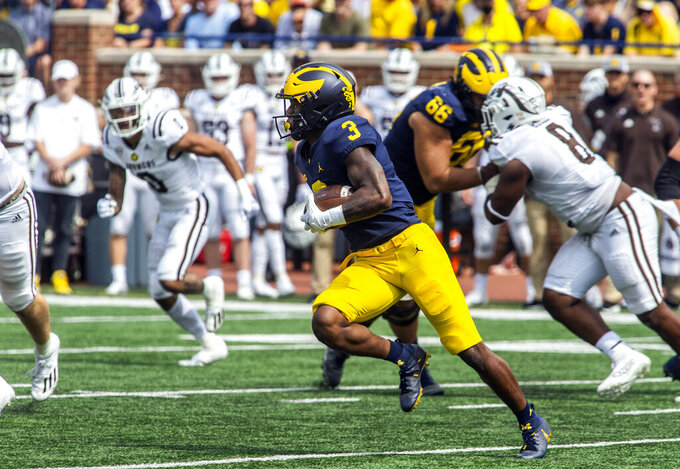 Michigan wide receiver A.J. Henning (3) rushes 74-yards for a touchdown in the third quarter of an NCAA college football game against Western Michigan in Ann Arbor, Mich., Saturday, Sept. 4, 2021. Michigan won 47-14. (AP Photo/Tony Ding)