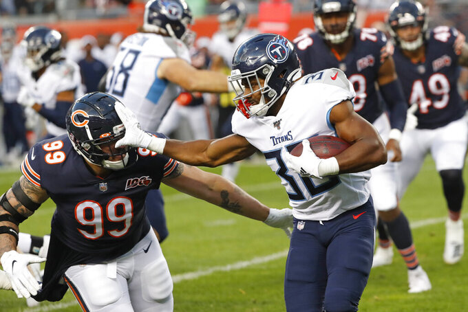 Tennessee Titans running back Jeremy McNichols (30) is chased by Chicago Bears outside linebacker Aaron Lynch (99) during the first half of an NFL preseason football game Thursday, Aug. 29, 2019, in Chicago. (AP Photo/Charles Rex Arbogast)