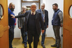 Brazilian former President Luiz Inacio Lula da Silva arrives for a meeting with Italian Cgil union, in Rome, Thursday, Feb. 13, 2020. Da Silva was released from prison in early November after 19 months in detention, when Brazil's Supreme Court ruled a person can be imprisoned only after all appeals have been exhausted. Da Silva, who governed Brazil from 2003 to 2010, denies wrongdoing and says corruption cases against him are politically motivated. (AP Photo/Andrew Medichini)