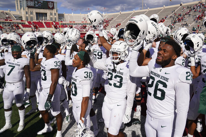Michigan State players celebrate following an NCAA college football game against Indiana, Saturday, Oct. 16, 2021, in Bloomington, Ind. Michigan State won 20-15. (AP Photo/Darron Cummings)