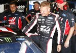 Clint Bowyer climbs into  his car before practice for a NASCAR cup series auto race at Michigan International Speedway, Friday, June 7, 2019, in Brooklyn, Mich. (AP Photo/Carlos Osorio)