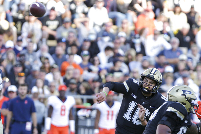 Purdue quarterback Aidan O'Connell (16) throws a pass against Illinois during the third quarter of an NCAA college football game, Saturday, Sept. 25, 2021, in West Lafayette, Ind. (Nikos Frazier/Journal & Courier via AP)