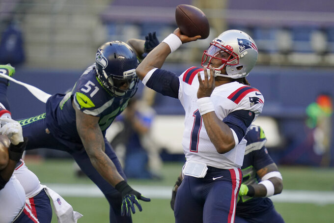New England Patriots quarterback Cam Newton (1) passes as Seattle Seahawks linebacker Bruce Irvin (51) closes in during the first half of an NFL football game, Sunday, Sept. 20, 2020, in Seattle. (AP Photo/Elaine Thompson)