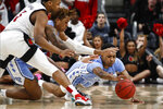 North Carolina guard Christian Keeling (55) dives for a loose ball during an NCAA college basketball game against Louisville Saturday, Feb. 22, 2020, in Louisville, Ky. (AP Photo/Wade Payne)