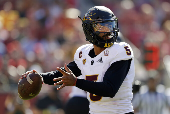 Arizona State quarterback Manny Wilkins (5) throws against Southern California during the first half of an NCAA college football game Saturday, Oct. 27, 2018, in Los Angeles. (AP Photo/Marcio Jose Sanchez)