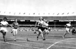 FILE - In this Nov. 26, 1956, file photo, Betty Cuthbert (468) of Australia runs past the finish line to win the women's Olympic 100 meters in Melbourne, Australia. (AP Photo)