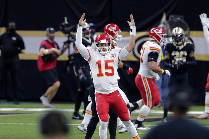 Kansas City Chiefs quarterback Patrick Mahomes (15) reacts after throwing a touchdown pass in the first half of an NFL football game against the New Orleans Saints in New Orleans, Sunday, Dec. 20, 2020. (AP Photo/Brett Duke)