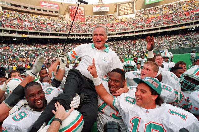 FILE - In this Nov. 14, 1993, file photo, Miami Dolphins coach Don Shula is carried on his team's shoulders after his 325th victory, against the Philadelphia Eagles in Philadelphia. Shula, who won the most games of any NFL coach and led the Miami Dolphins to the only perfect season in league history, died Monday, May 4, 2020, at his South Florida home, the team said. He was 90.  (AP Photo/ George Widman)