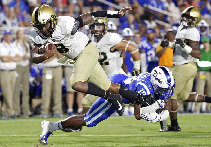 Duke's Marquis Waters (10) tackles Army quarterback Kelvin Hopkins Jr. (8) during the second half of an NCAA college football game in Durham, N.C., Friday, Aug. 31, 2018. Duke won 34-14. (AP Photo/Gerry Broome)