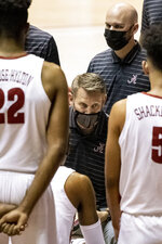 Alabama head coach Nate Oats works with his team during the first half of an NCAA college basketball game against Western Kentucky, Saturday, Dec. 19, 2020, in Tuscaloosa, Ala. (AP Photo/Vasha Hunt)