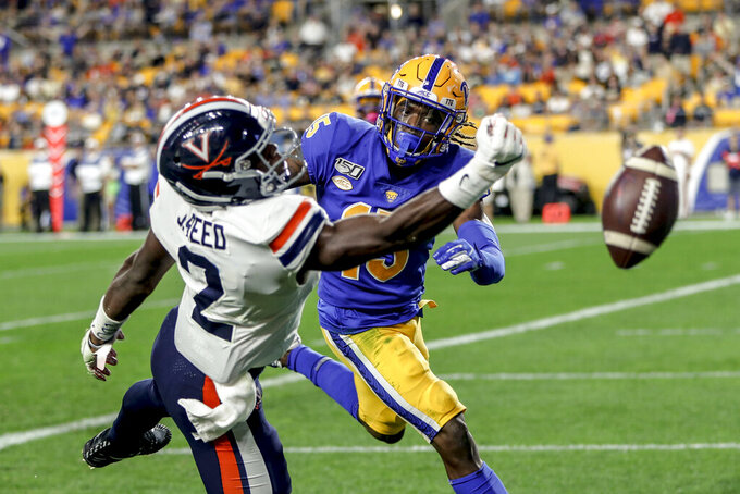 Virginia wide receiver Joe Reed (2) cannot pull in a pass in the end zone as Pittsburgh defensive back Jason Pinnock (15) defends in the second half of an NCAA college football game Saturday, Aug. 31, 2019, in Pittsburgh. (AP Photo/Keith Srakocic)
