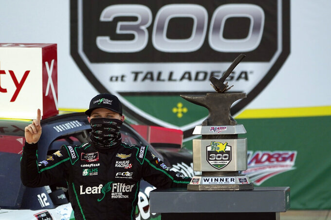 Justin Haley celebrates in Victory Lane after winning  a NASCAR Xfinity Series auto race at Talladega Superspeedway, Saturday, Oct. 3, 2020, in Talladega, Ala. (AP Photo/John Bazemore)