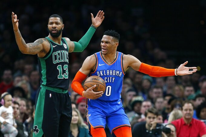 Oklahoma City Thunder's Russell Westbrook (0) protests a call beside Boston Celtics' Marcus Morris (13) during the first half of an NBA basketball game in Boston, Sunday, Feb. 3, 2019. (AP Photo/Michael Dwyer)