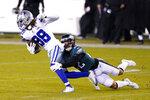 Dallas Cowboys' CeeDee Lamb (88) tries to get past Philadelphia Eagles' Marcus Epps (22) during the second half of an NFL football game, Sunday, Nov. 1, 2020, in Philadelphia. (AP Photo/Chris Szagola)