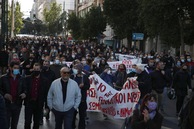 Protesters wearing face masks to curb the spread of COVID-19 take part in a rally during a 24-hour strike, on Thursday, Nov. 26, 2020. Civil servants in Greece have walked off the job in a 24-hour strike expected to disrupt public transport and services, on a variety of demands, including better workplace protections against the coronavirus. (AP Photo/Thanassis Stavrakis)