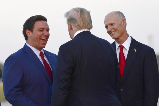 Donald Trump, Rick Scott, Ron DeSantis