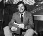 FILE - In this Aug. 11, 1970 file photo, New York Yankees pitcher Jim Bouton, holds a copy of his book