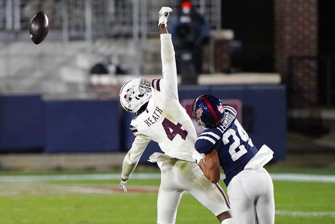 Mississippi State wide receiver Malik Heath (4) reaches for a tipped pass as Mississippi defensive back Deane Leonard (24) defends during the second half of an NCAA college football game Saturday, Nov. 28, 2020, in Oxford, Miss. Mississippi won 31-24. (AP Photo/Rogelio V. Solis)