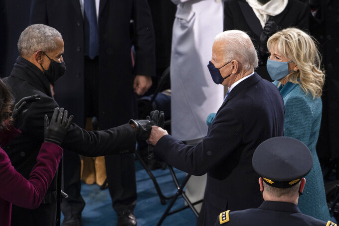 President-elect Joe Biden greets former President Barack Obama as he arrives at the West Front of the Capitol, Wednesday, Jan. 20, 2021, in Washington. (Caroline Brehman/Pool Photo via AP)