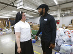 FILE - In this June 27, 2019, file photo, Sister Marie Jose De La Rosa, from New Jersey, chats with Washington Redskins cornerback Josh Norman at the Humanitarian Respite Center in McAllen, Texas. Most NFL players don't have the kind of offseason adventures of Josh Norman, who flew with the Blue Angels, visited and donated to an immigrant detention center in Texas and jumped over a bull while running with the bulls in Pamplona, Spain. (Delcia Lopez/The Monitor via AP, File)