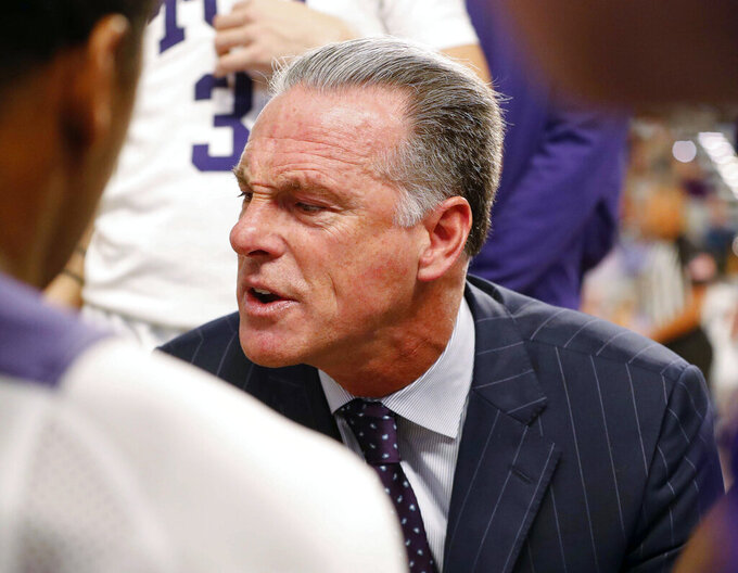 TCU coach Jamie Dixon talks to the team during a timeout during the second half of an NCAA college basketball game against Southern California in Fort Worth, Texas, Friday, Dec. 6, 2019. (Bob Booth/Star-Telegram via AP)