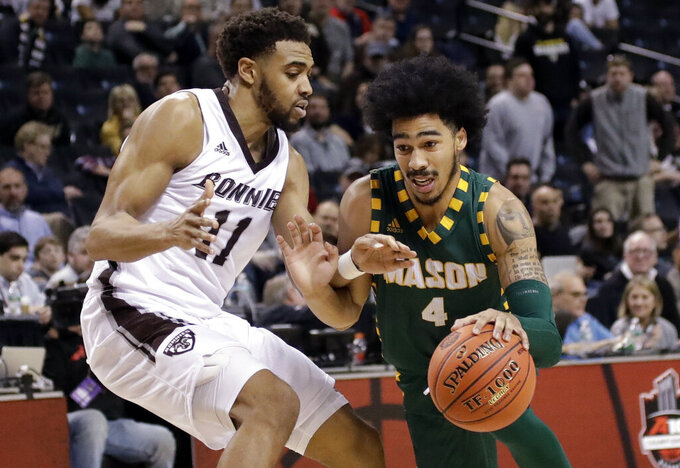 St. Bonaventure's Courtney Stockard (11) defends as George Mason's Otis Livingston II (4) drives to the basket during the second half of an NCAA college basketball game in the Atlantic 10 men's tournament Friday, March 15, 2019, in New York. St. Bonaventure won 68-57. (AP Photo/Frank Franklin II)
