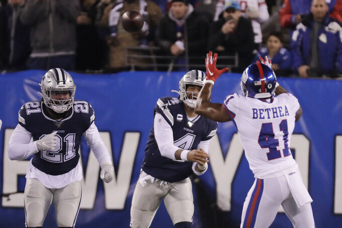 New York Giants free safety Antoine Bethea (41) intercepts a pass from Dallas Cowboys quarterback Dak Prescott (4) during the first quarter of an NFL football game, Monday, Nov. 4, 2019, in East Rutherford, N.J. (AP Photo/Adam Hunger)