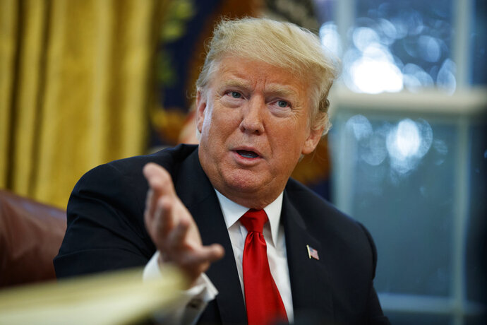 In this Oct. 16, 2018 photo, President Donald Trump speaks during an interview with The Associated Press in the Oval Office of the White House in Washington. (AP Photo/Evan Vucci)