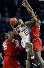 Temple's Nate Pierre-Louis, center, tries to get a shot past Houston's Fabian White Jr., left, and Brison Gresham during the first half of an NCAA college basketball game, Wednesday, Jan. 9, 2019, in Philadelphia. (AP Photo/Matt Slocum)