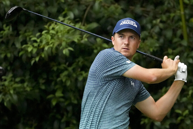 Jordan Spieth watches his drive on the 14th tee during the first round of the Masters golf tournament on Thursday, April 8, 2021, in Augusta, Ga. (AP Photo/Charlie Riedel)