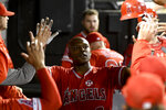 Los Angeles Angels' Justin Upton (8) celebrates in the dugout after hitting a home run off Chicago White Sox's Alex Colome during the ninth inning of a baseball game Friday, Sept. 6, 2019, in Chicago. (AP Photo/Matt Marton)
