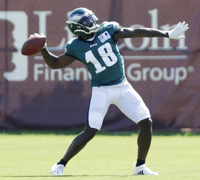 Philadelphia Eagles wide receiver Jalen Reagor throws the football during an NFL football training camp practice in Philadelphia, Monday, Aug. 17, 2020. (Yong Kim/Pool Photo via AP)