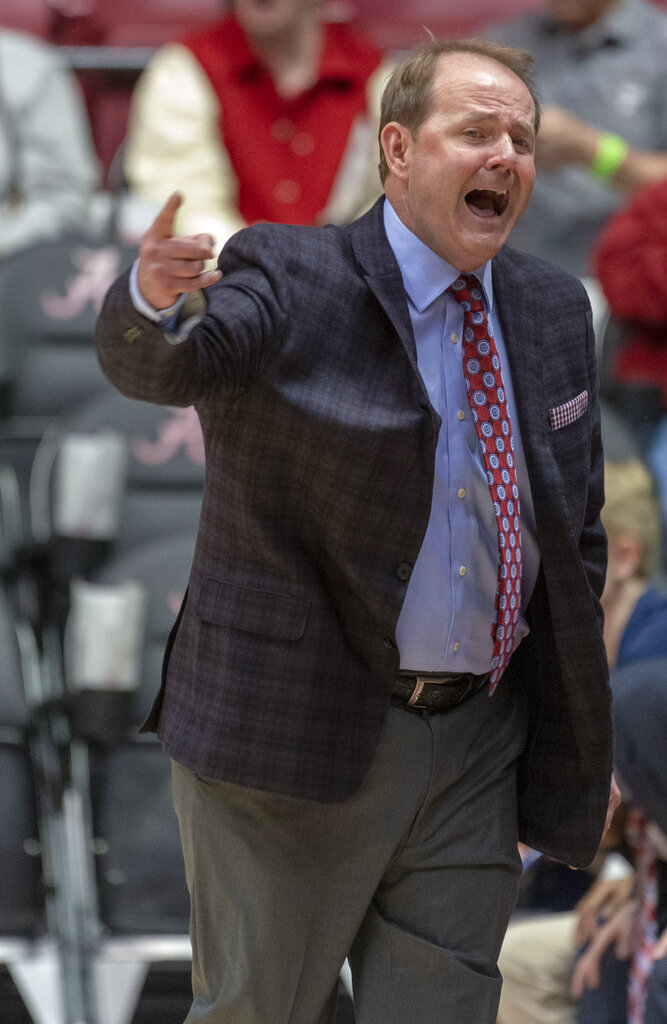 Mississippi head coach Kermit Davis yells in to his players against Alabama during the first half of an NCAA college basketball game, Tuesday, Jan. 22, 2019, in Tuscaloosa, Ala. (AP Photo/Vasha Hunt)