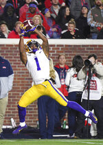 LSU wide receiver Ja'Marr Chase catches a 34-yard touchdown pass during the first half of the team's NCAA college football game against Mississippi in Oxford, Miss., Saturday, Nov. 16, 2019. (AP Photo/Thomas Graning)