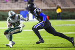 Charlotte wide receiver Micaleous Elder (23) runs with the ball while Duke defensive end Chris Rumph II (96) chases him during an NCAA college football game Saturday, Oct. 31, 2020, in Durham, N.C. (Jaylynn Nash/Pool Photo via AP)