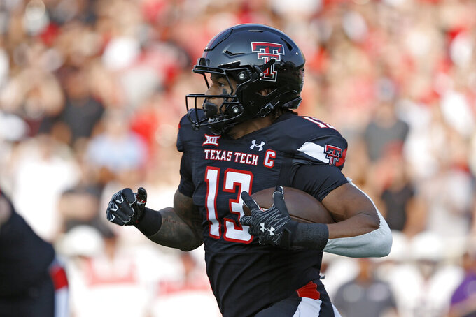 Texas Tech's Erik Ezukanma (13) runs with the ball during the first half of the team's NCAA college football game against Stephen F. Austin, Saturday, Sept. 11, 2021, in Lubbock, Texas. (AP Photo/Brad Tollefson)
