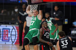 Boston Celtics' Daniel Theis (27)n hangs from the basket in front of Toronto Raptors' Pascal Siakam (43) and Marc Gasol (33) after a dunk in the second half of an NBA conference semifinal playoff basketball game Thursday, Sept 3, 2020, in Lake Buena Vista Fla. (AP Photo/Mark J. Terrill)